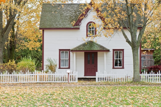 white picket fence home
